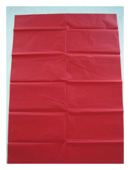 Unfold sheets of tissue paper