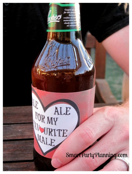 Man holding a beer with a Valentine beer label attached