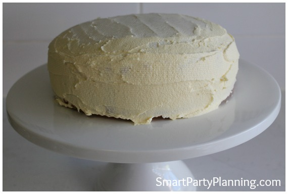Cover cake with vanilla frosting