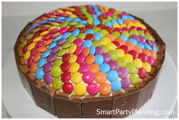 Smarties and kit kat fingers on a cake