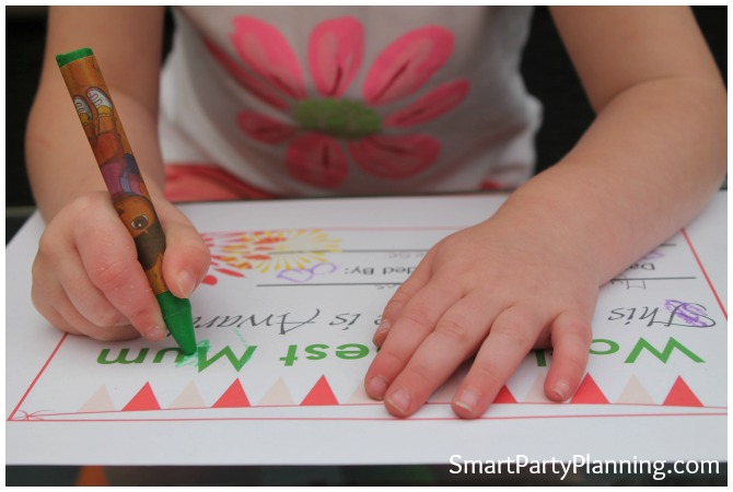 Child completing the Free Mother's Day Certificate