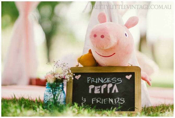 Peppa Pig holding a sign