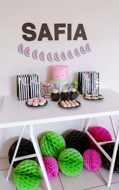 Table display with watermelon birthday cake