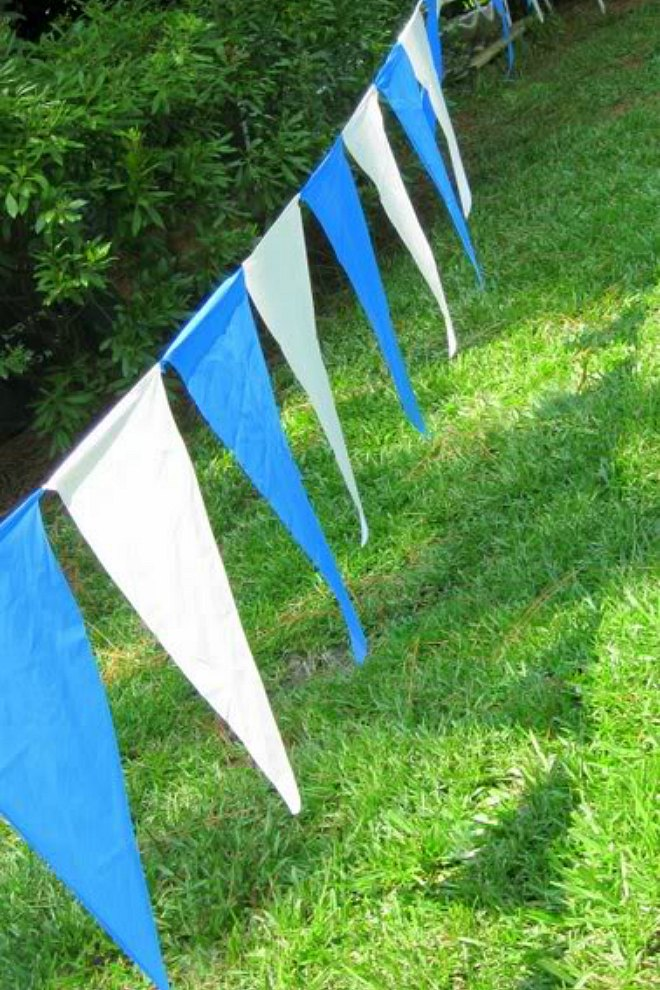 Blue and white plastic tablecloth bunting