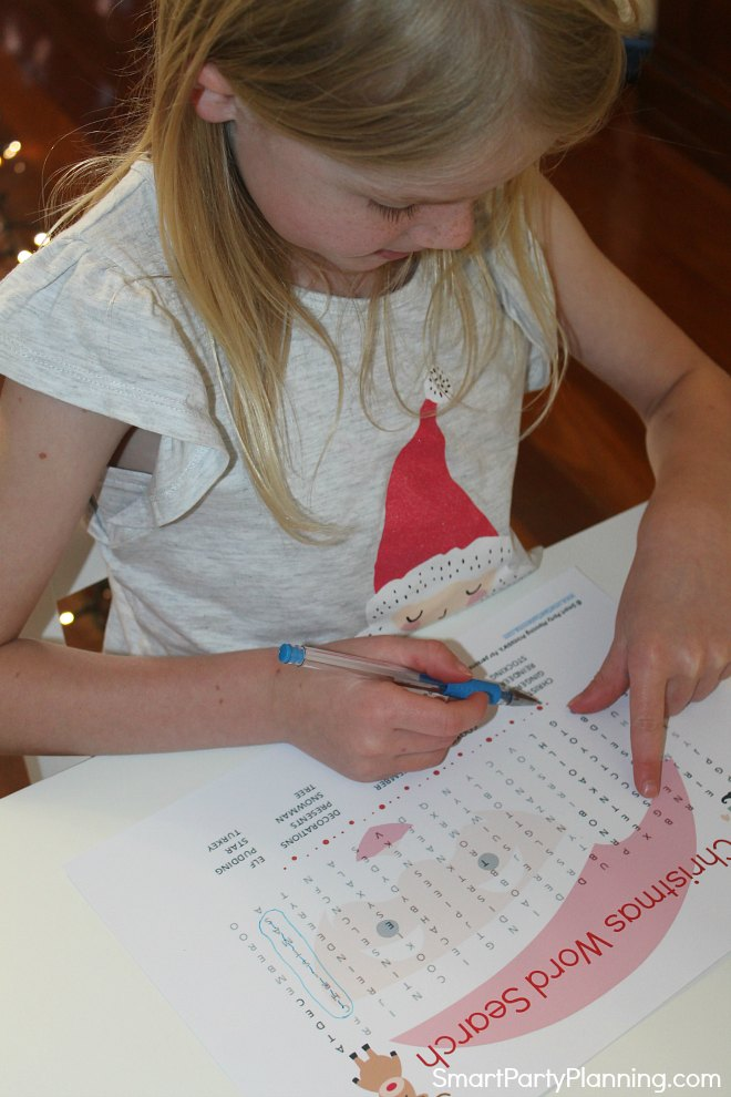 Completing the Christmas word search puzzle
