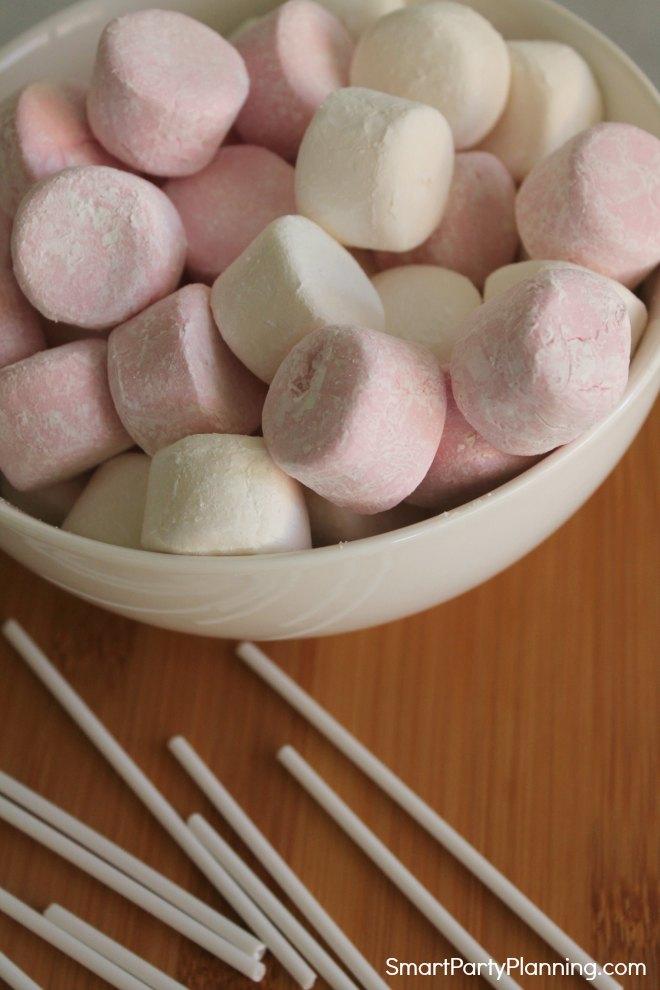 marshmallows and cake pop sticks