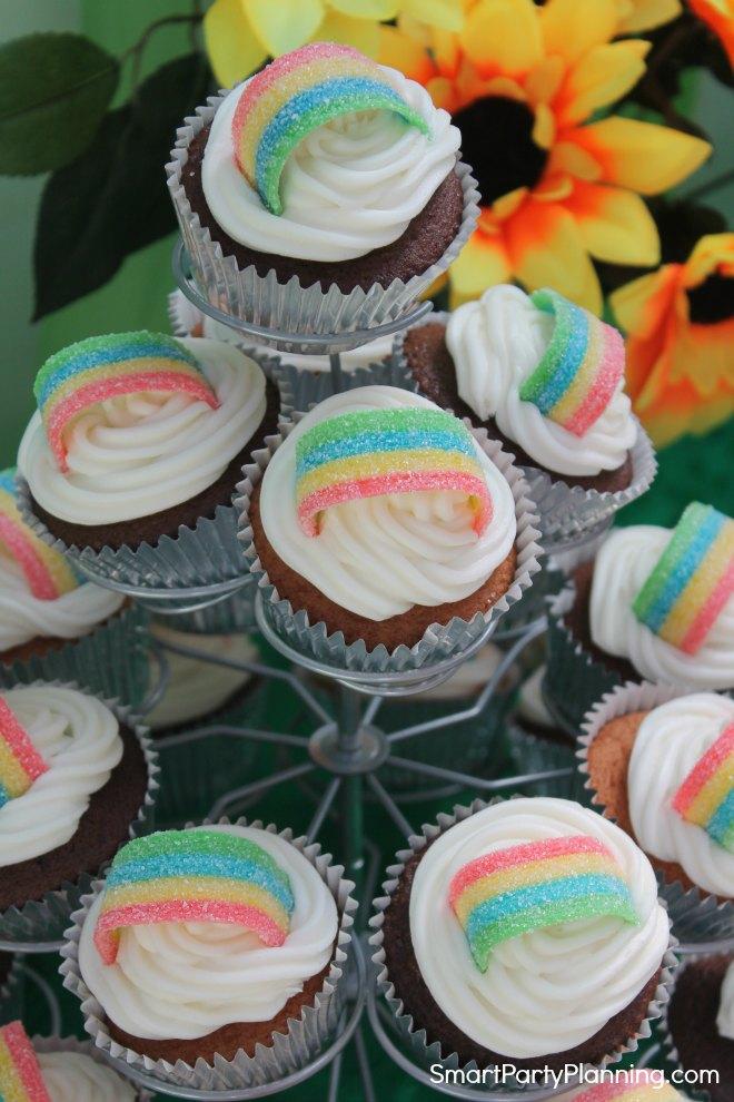 Stand of vanilla and chocolate rainbow cupcakes