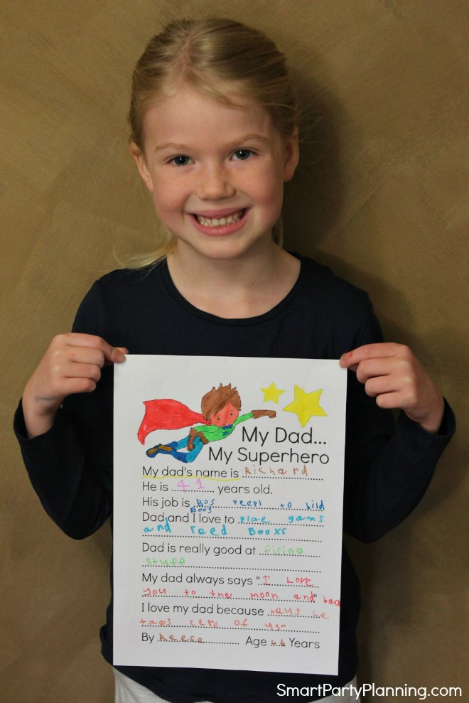 Child showing off the completed father's day questionnaire