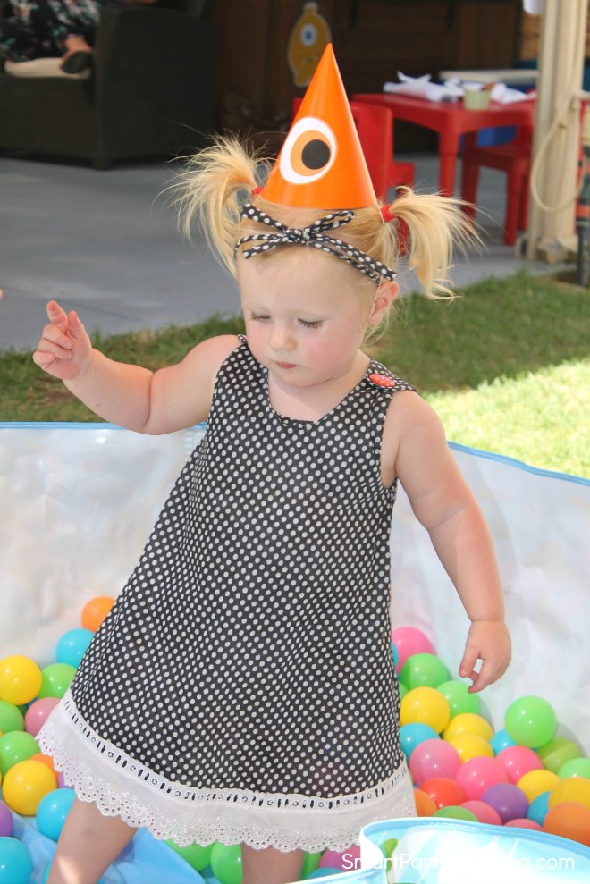 Girl wearing a monster party hat