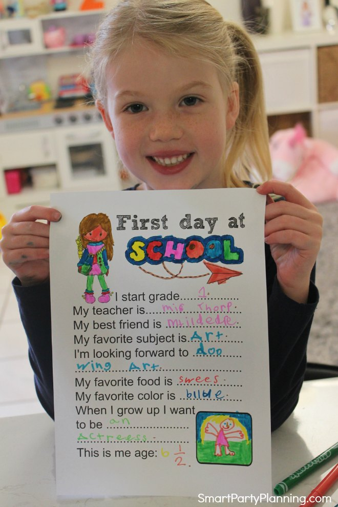 Girl holding the first day of school questionnaire