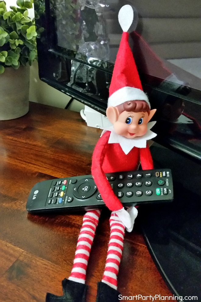 Elf on the shelf watches television