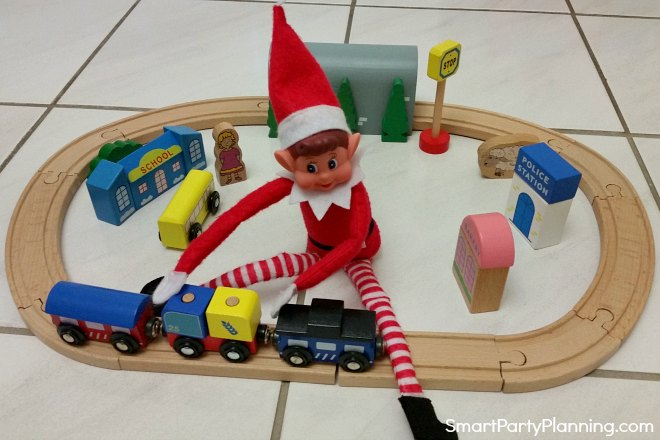 elf on the shelf plays with the train set