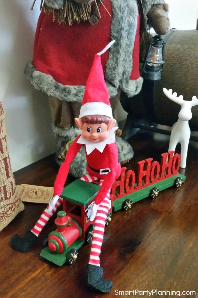 elf sits on a toy train