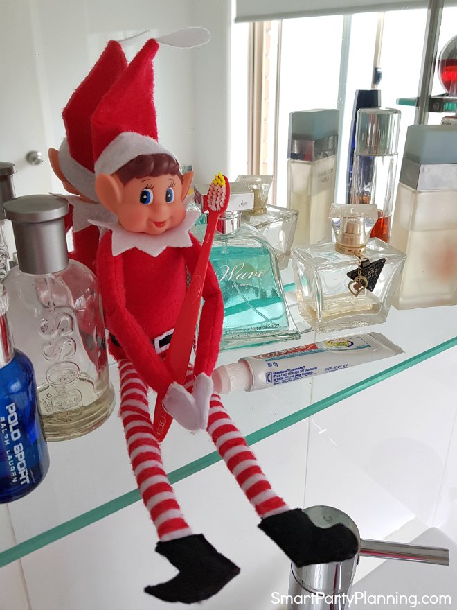 Elf on the shelf cleaning his teeth