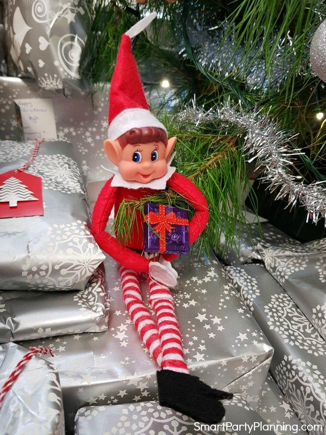 Elf on the shelf eating Christmas tree chocolate