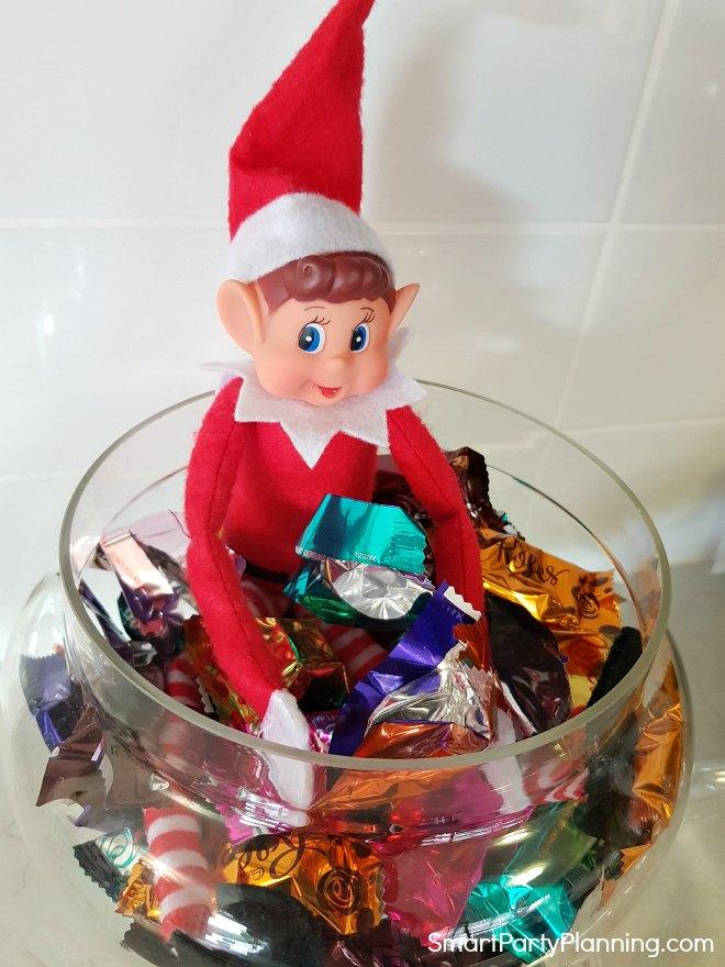 Elf on the shelf eating chocolates