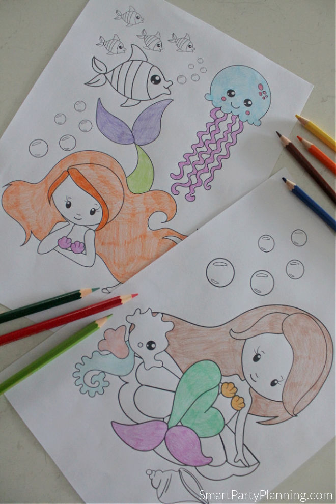 two sitting down mermaid coloring pages