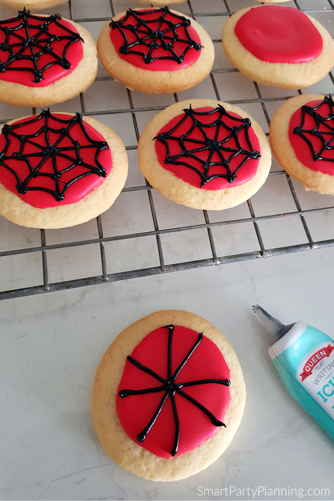 Adding 4 web segments onto spiderman cookies