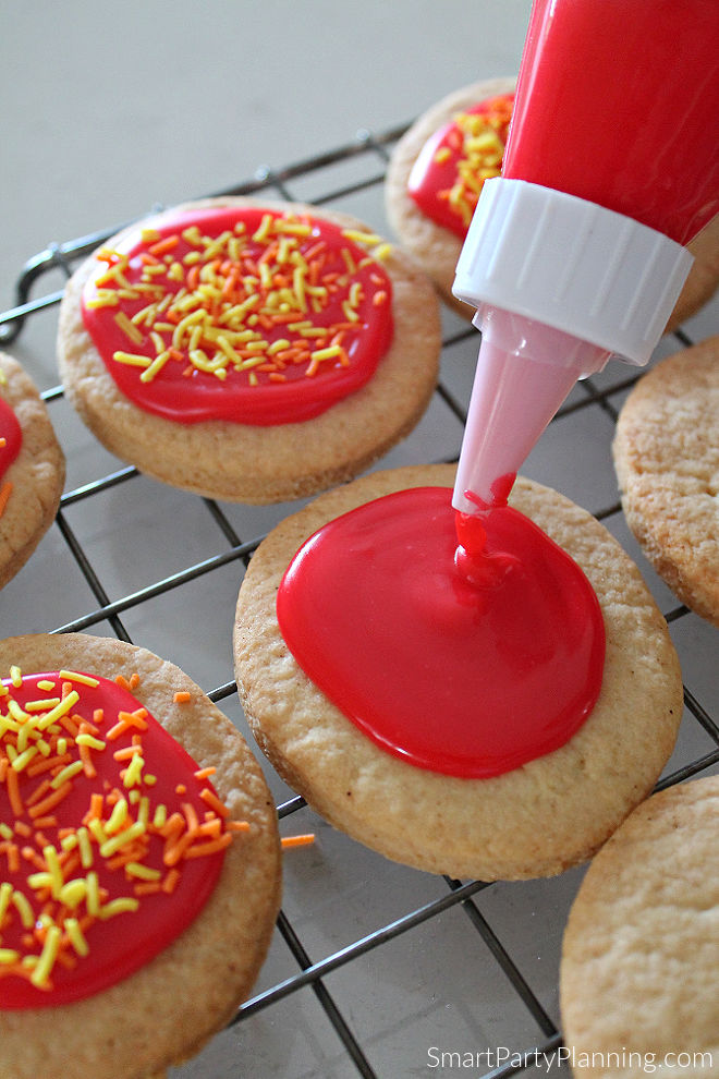 Adding red icing to the cookie