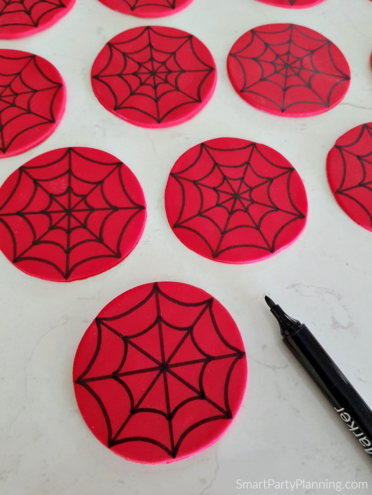Completed web on fondant spiderman cupcake toppers
