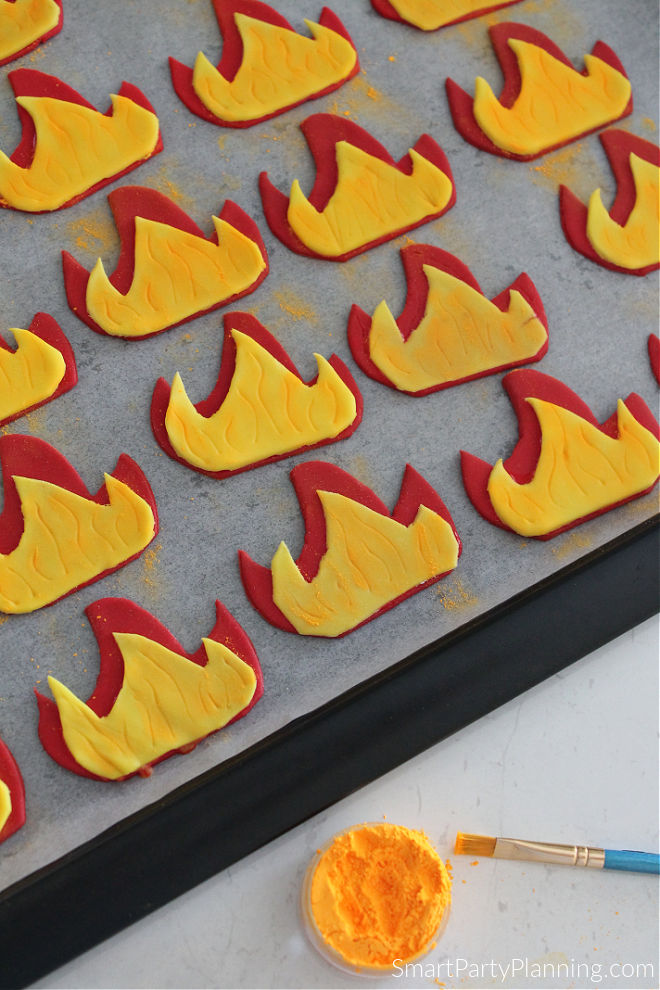 Cover fondant flames with glitter powder