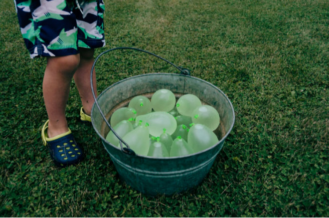 Kid and water balloons