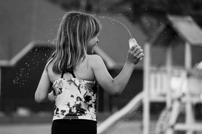 child throwing a water balloon